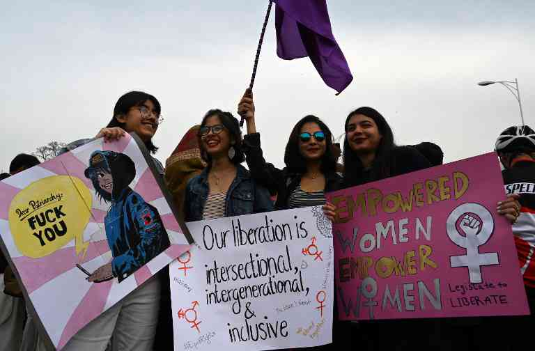Pakistani civil society activists carry placards and shout slogans during a rally for women rights on International Women's Day in Islamabad on March 8, 2019. (Photo credit: Aamir Qureshi /AFP).