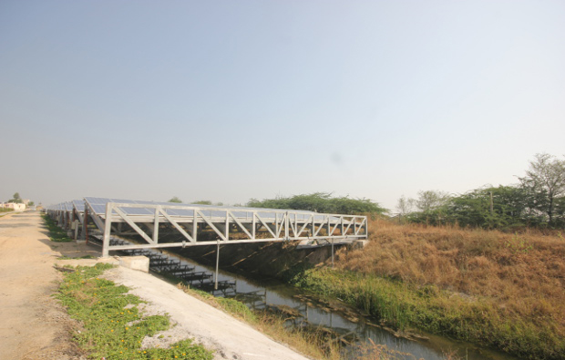 As the midday sun beats down relentlessly, solar panels fixed at an angle atop a 750 m long length of canal in Chandrasan village, Mehsana district, in India's sunniest state of Gujarat, work quietly to produce power while saving evaporation of water that runs beneath. Image Credit: Mukta Patil