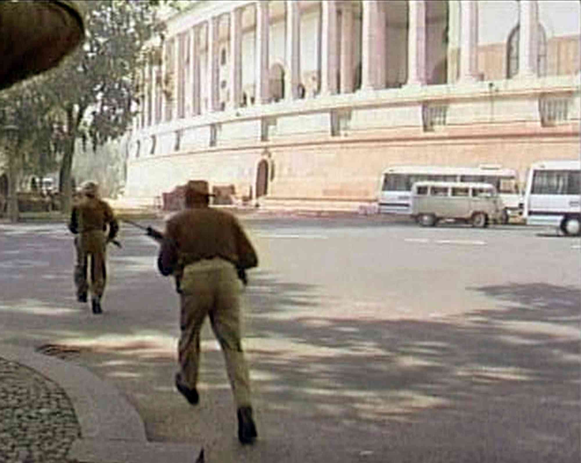 Security personnel in the Indian Parliament complex run for cover during the December 2001 terrorist attack in which 14 people, including five gunmen, were killed. The terrorists belonged to the Lashkar-e-Taiba and the Jaish-e-Mohammed. (Photo credit: Reuters)