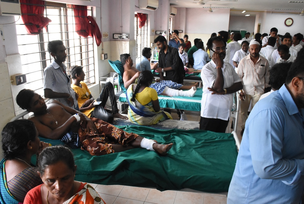 Injured protesters and their relatives at a government hospital in Tuticorin on Tuesday. (Photo credit: AFP)