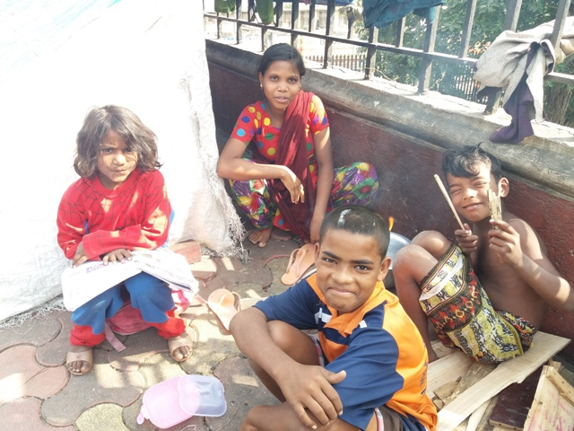 Archana Shaikh with other children from her family on the pavement where they live.