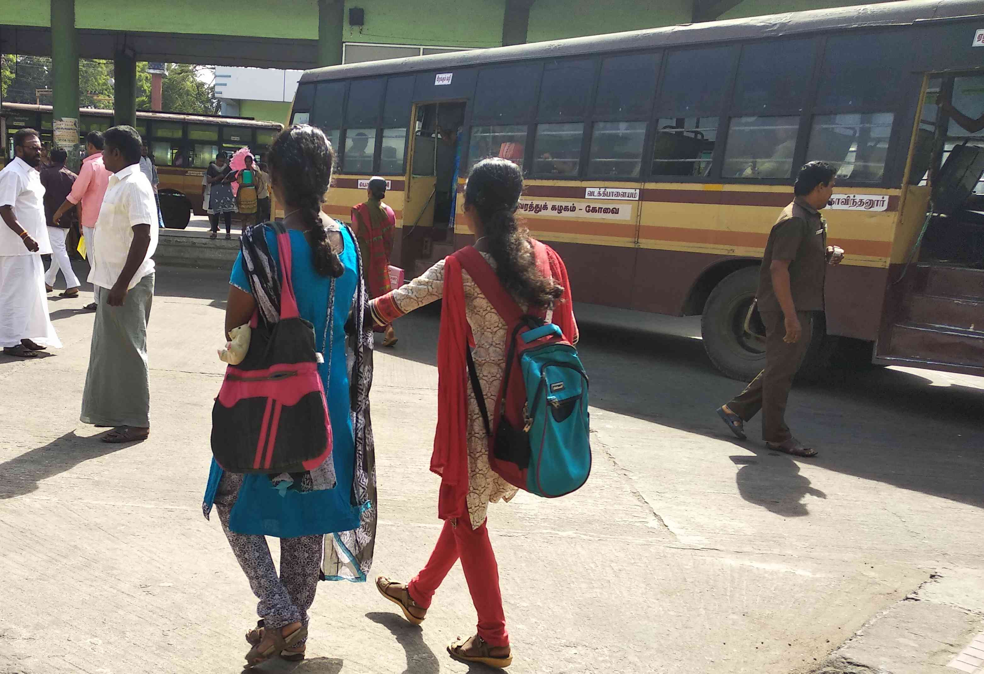 Students walk towards the bus stand after Pollachi's colleges declared a holiday on March 14. Photo credit: S Senthalir