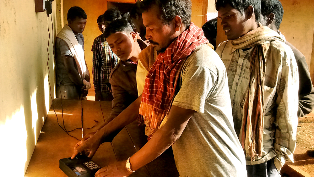 Workers line up at the biometric device to mark their attendance at the New Amtipani mine.
