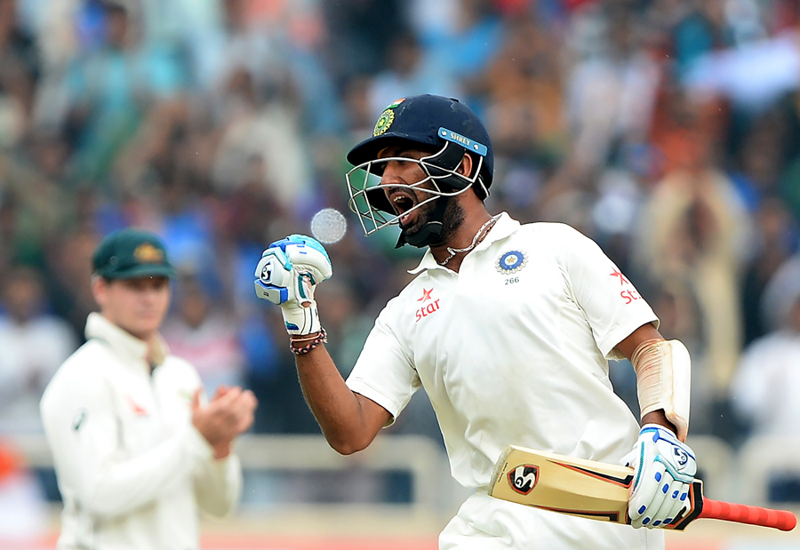 Pujara exults after reaching his double-century in Ranchi. Image credit: Sajjad Hussain/AFP