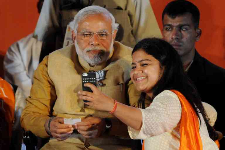Narendra Modi with BJP MP Poonam Mahajan. Photo credit: Indranil Mukherjee/AFP