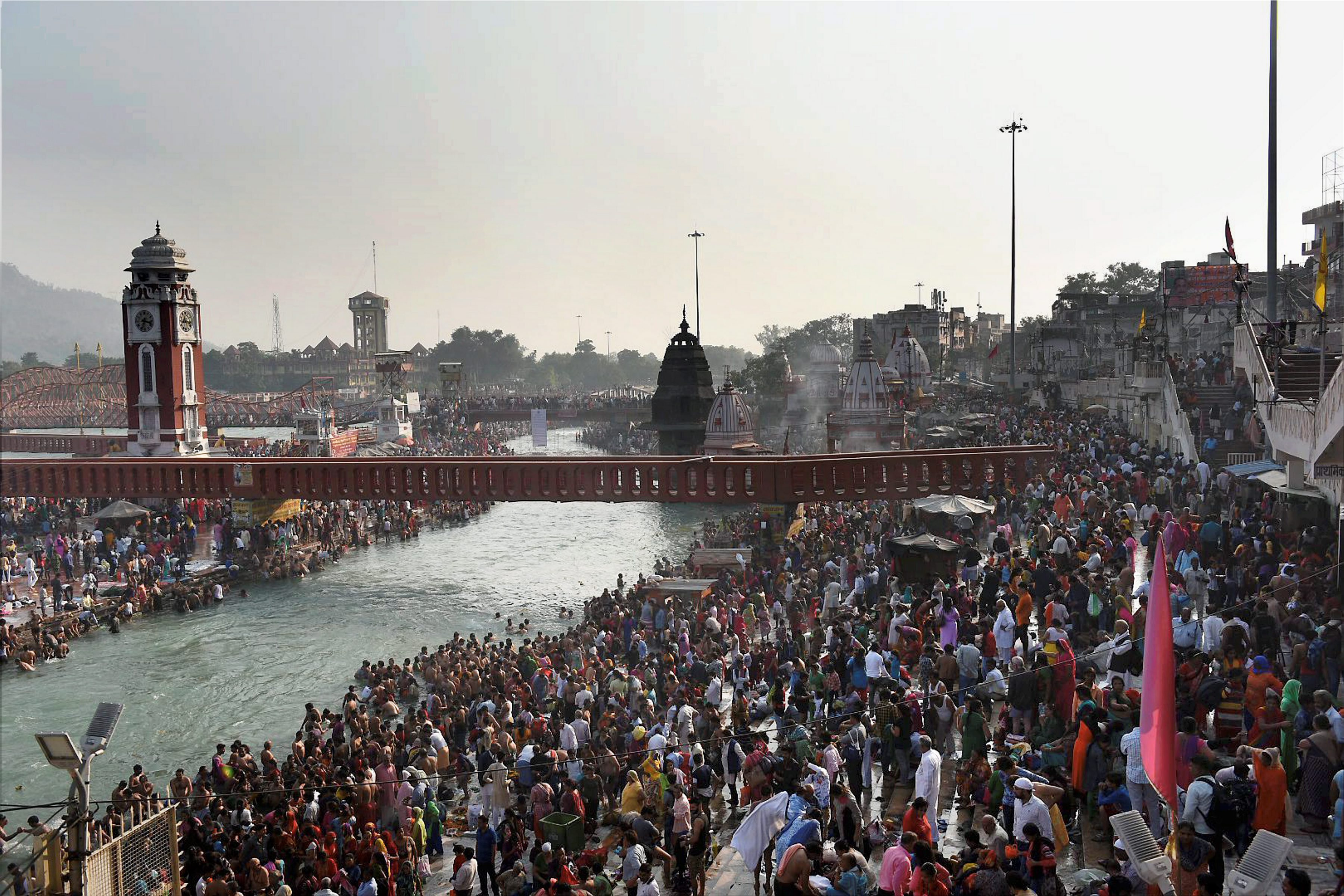 Haridwar's Har ki Paidi ghat by the Ganga is crowded with devotees there to offer prayers on Kartik Purnima. (Credit: PTI)