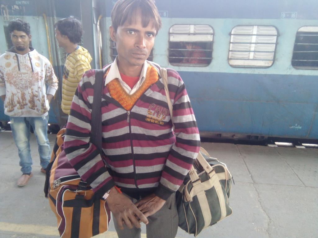 Angad Tiwari, who lost his job, waits for his train on Platform 13 at the New Delhi Railway Station on Thursday.