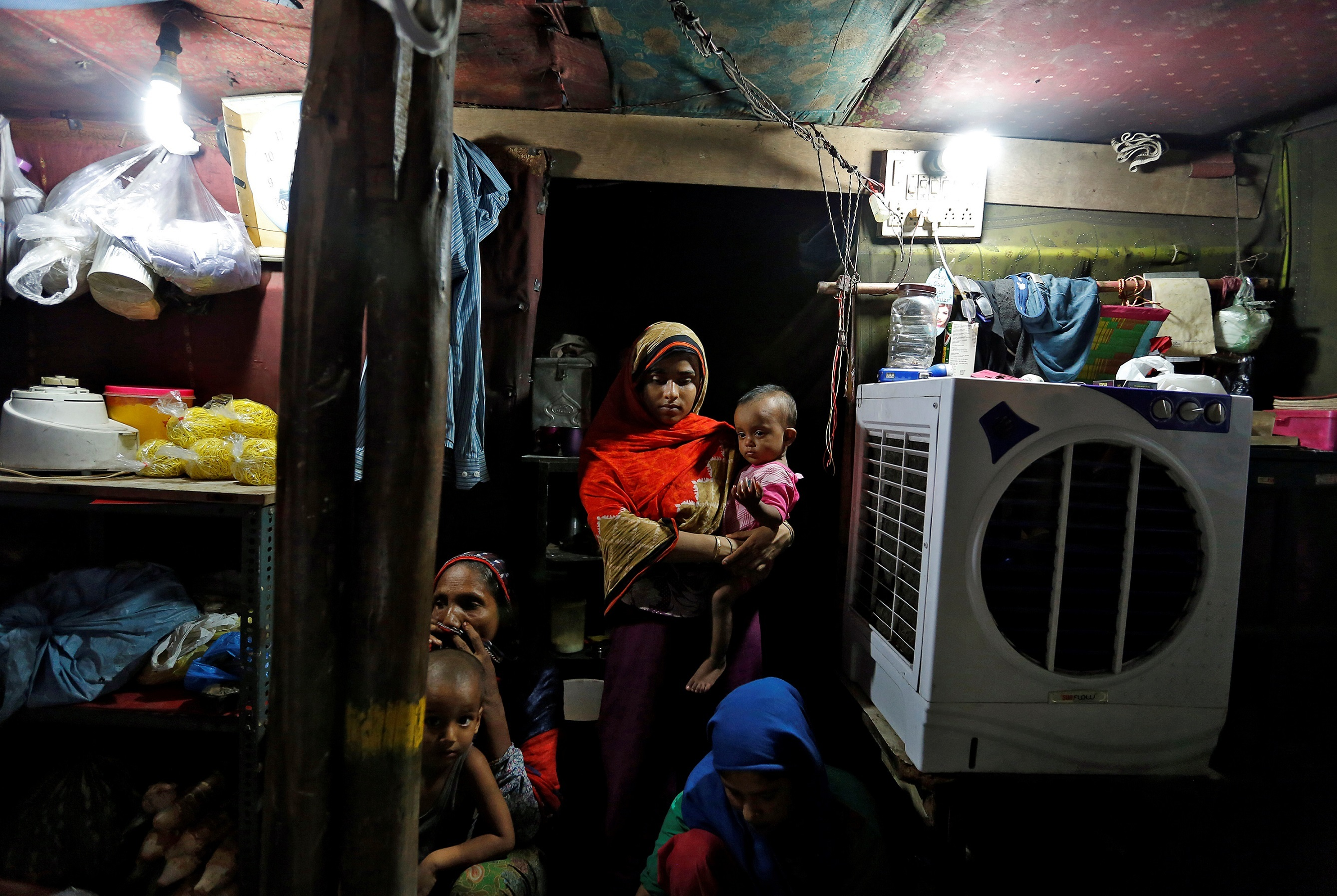 A Rohingya family inside their shack in a camp in Delhi. (Credit: Cathal McNaughton / Reuters)