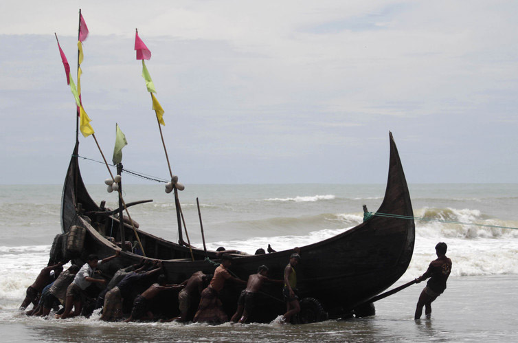 Rohingya fishermen near a refugee camp in Teknaf, 2011. ( Photo credit: Andrew Biraj / Reuters )