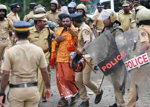 Kerala Police take a protestor into custody at Nilakkal (AFP)
