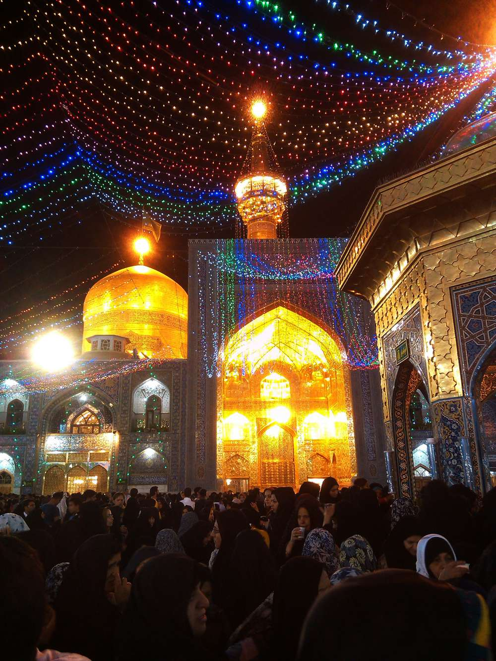 The shrine of Imam Reza is illuminated on the night of Eid-e-Ghadeer in Mashhad (Khorasan). According to Shia Islam, Ghadeer is the day when Prophet Muhammad appointed Imam Ali as his successor. The Golden Dome on top of Imam Ridha's tomb is the most prominent symbol of Mashhad.