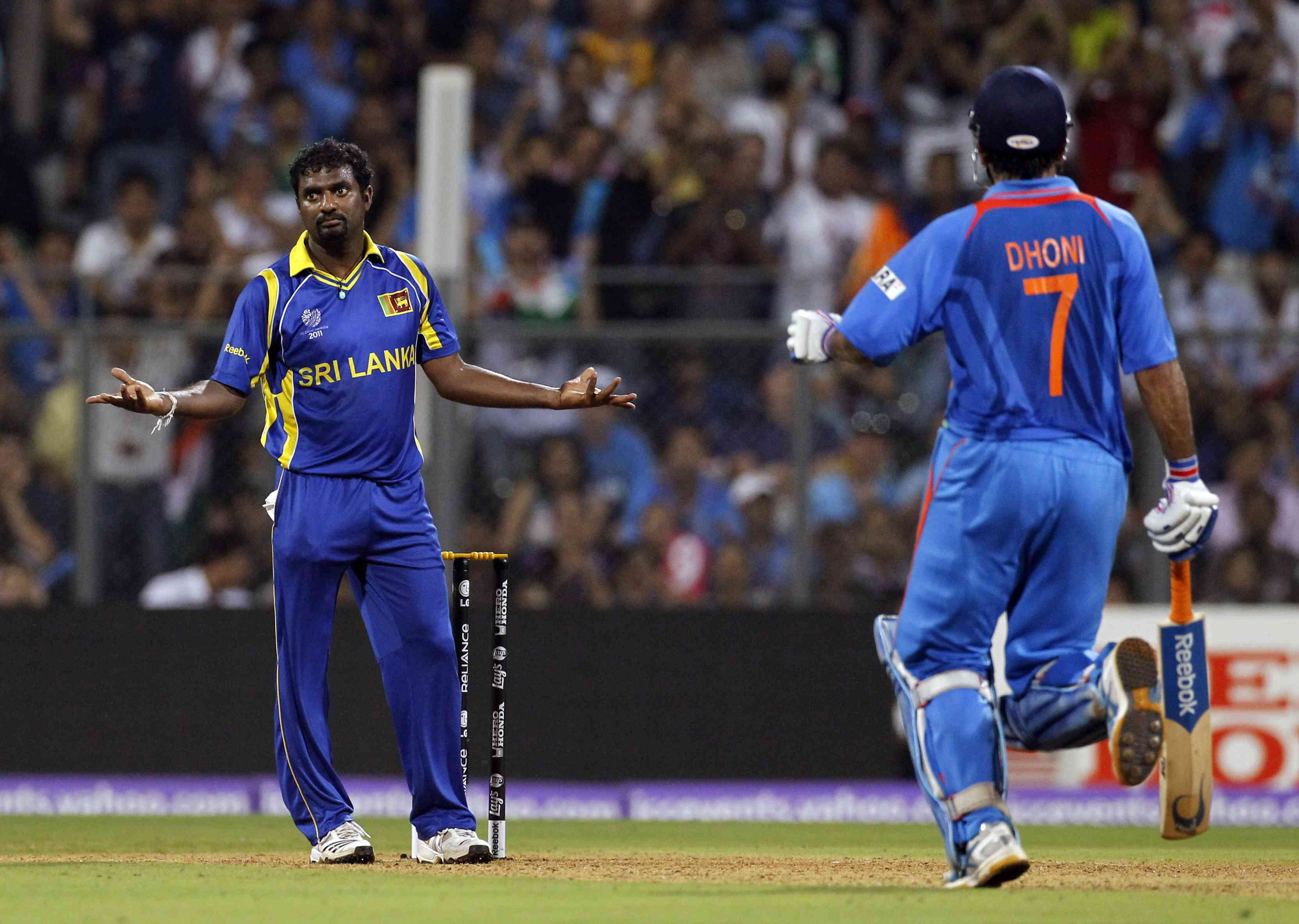 Spin ace Muttiah Muralidaran reacts as MS Dhoni countered him in style| Image credit: Vivek Prakash/Reuters