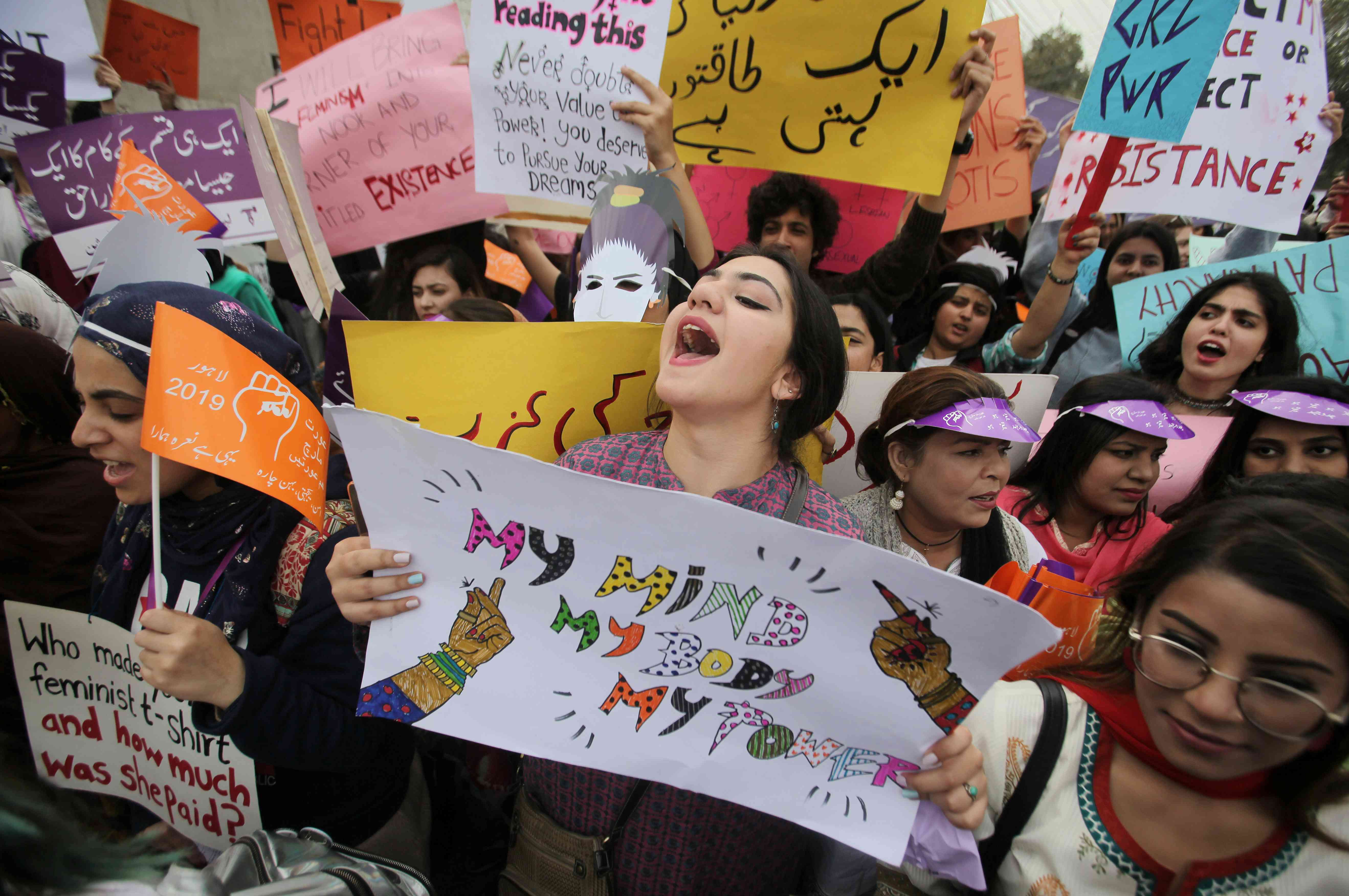 A woman carries a sign and chants slogans during a rally to mark International Women's Day in Lahore, Pakistan March 8, 2019. (Photo credit: Reuters/Mohsin Raza).