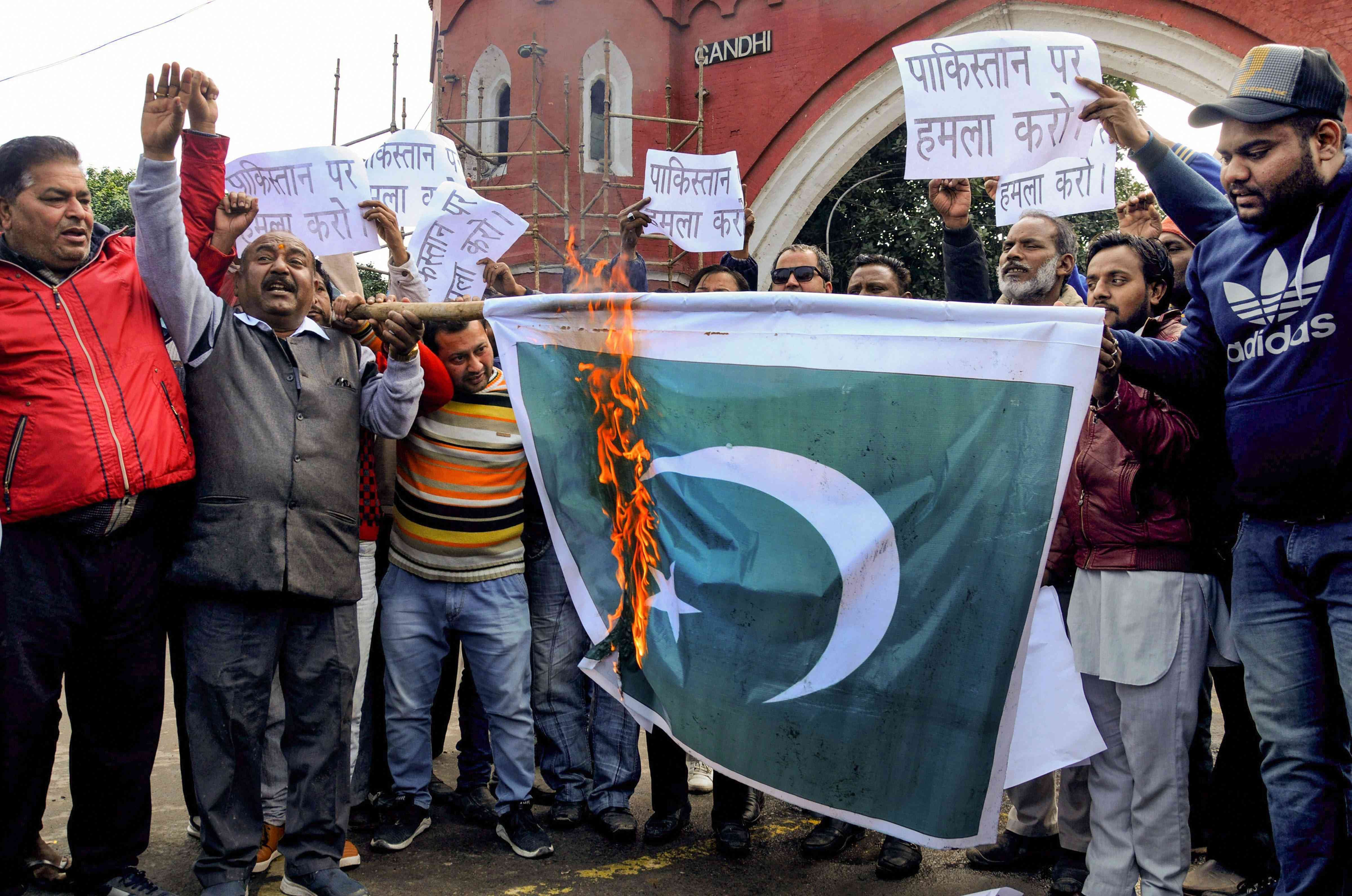 Congress workers in Amritsar set fire to a Pakistan flag and raise banners calling for action against Pakistan. Credit: PTI.