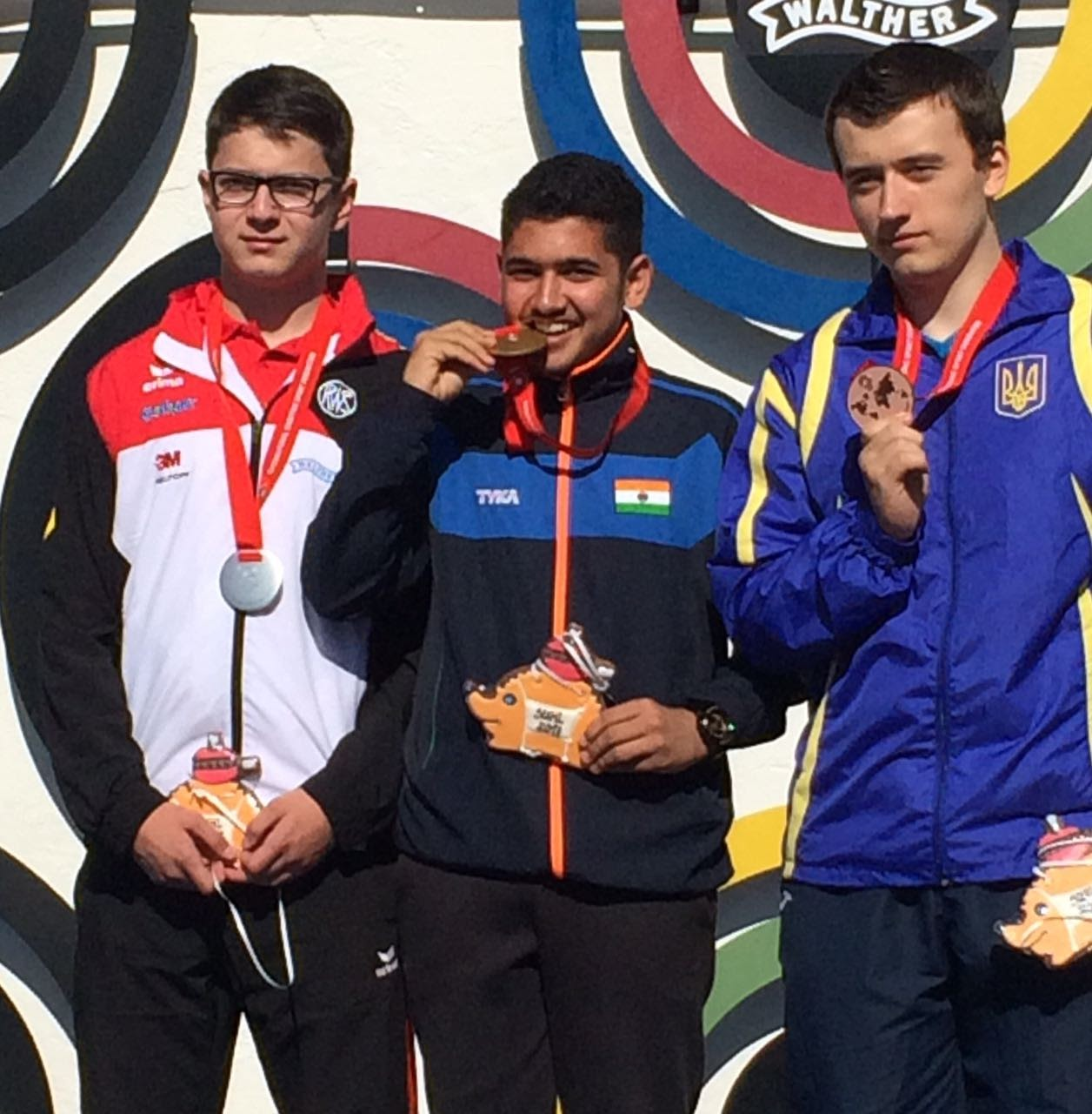Anish with his gold medal at the ISSF Junior World Cup. Image Credit: Anish Bhanwala