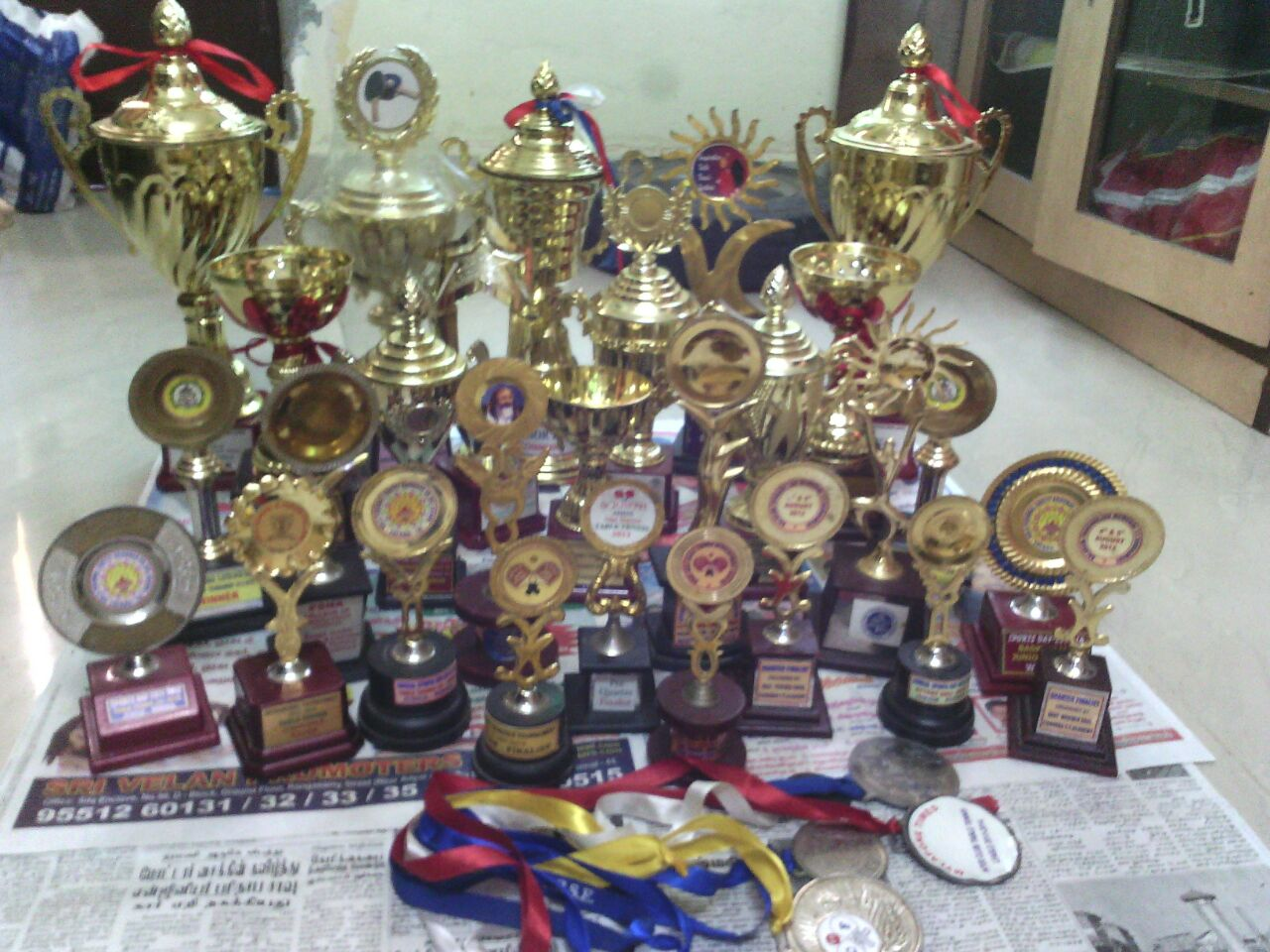 A collection of medals and trophies won by Malesh Kumar Yadav and Vaishnavi
