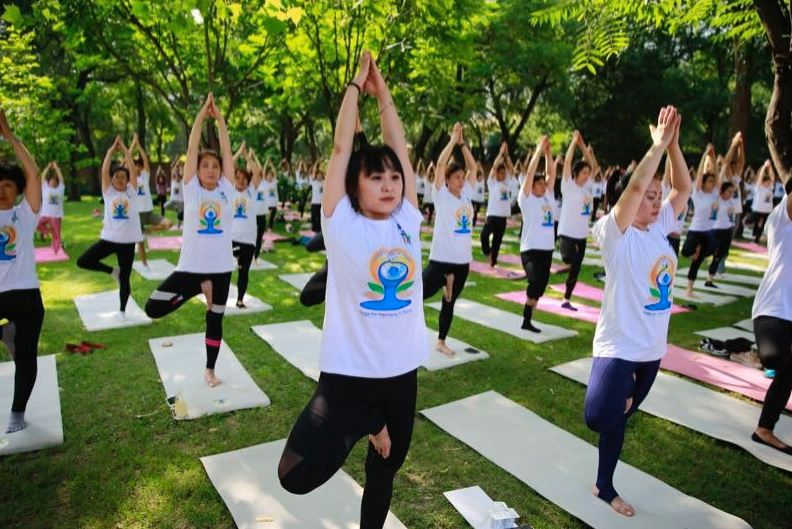 People perform yoga in Beijing, China (PIB India/Twitter)