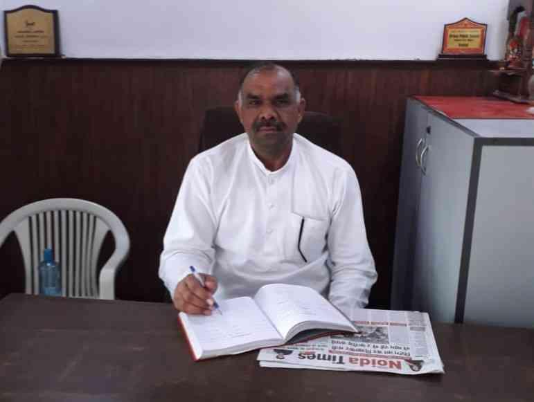 Ved Prakash in his office in Harola village, Noida, Gautam Buddh Nagar (Credit: Sumit Prakash)