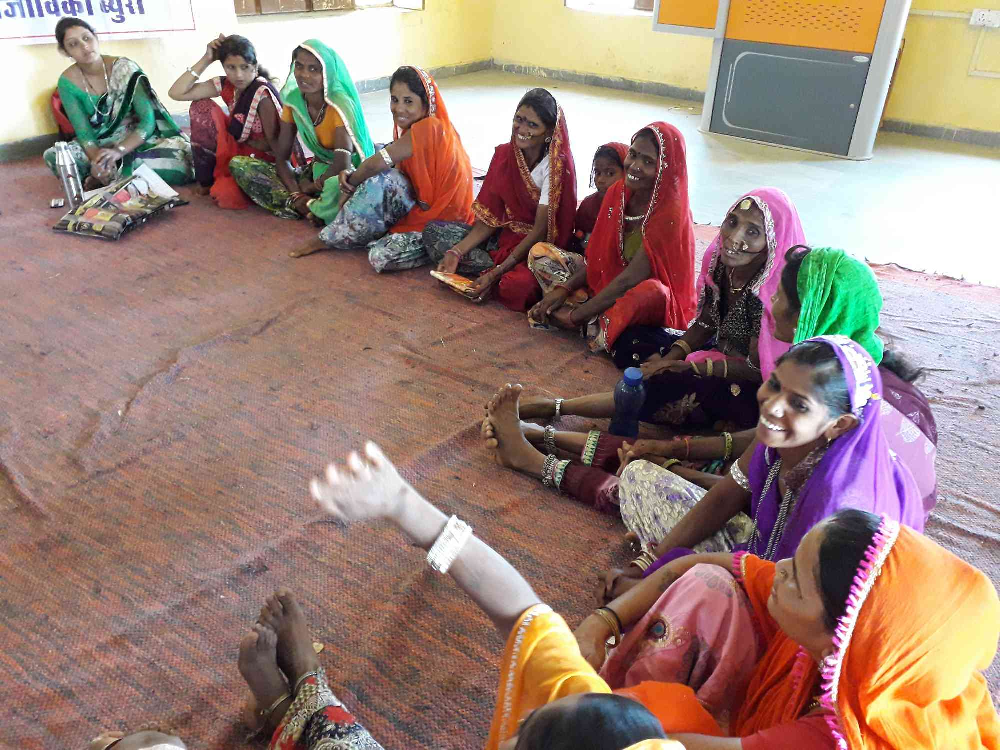 Members of Salumbar block's Ujala collective discuss their expectations from the government at a meeting on April 19. Photos: Aarefa Johari