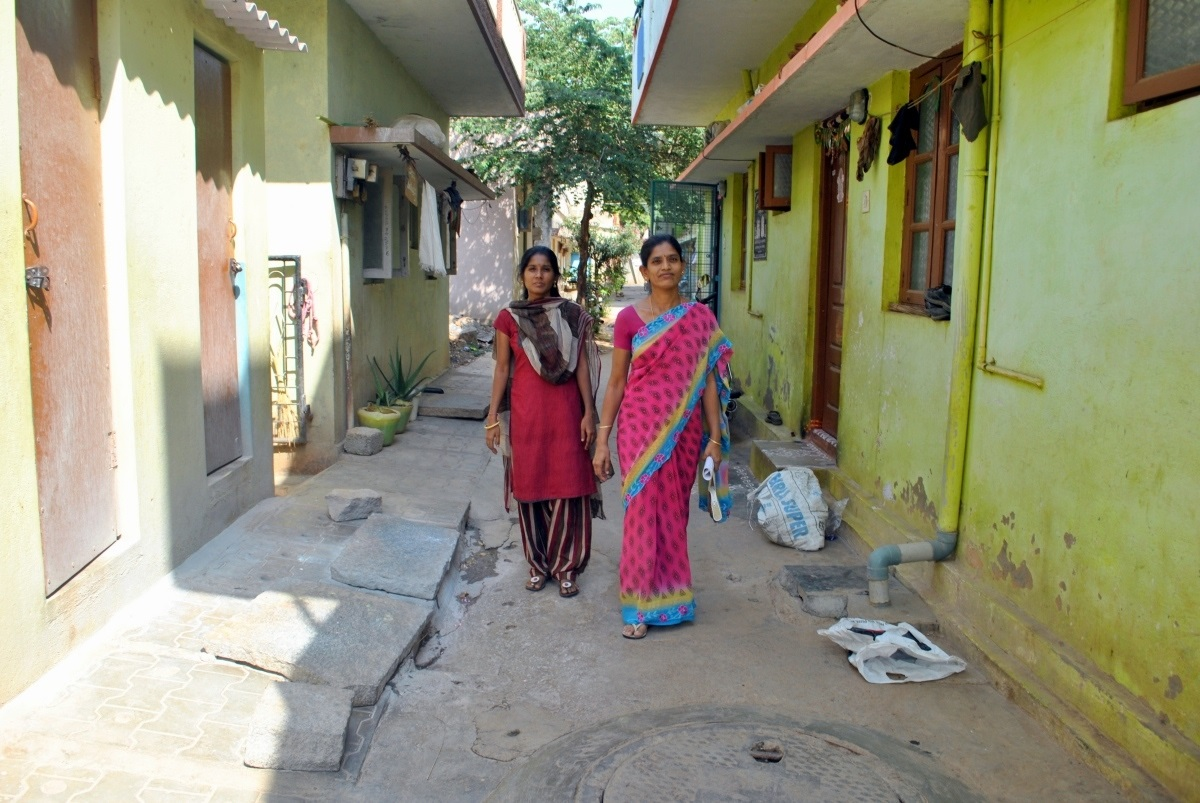 Workers Jayalakshmi and Uma walk through a neighbourhood near Peenya in Bengaluru. Most houses here are rented by garment workers. (Photo credit: Rohini Mohan)