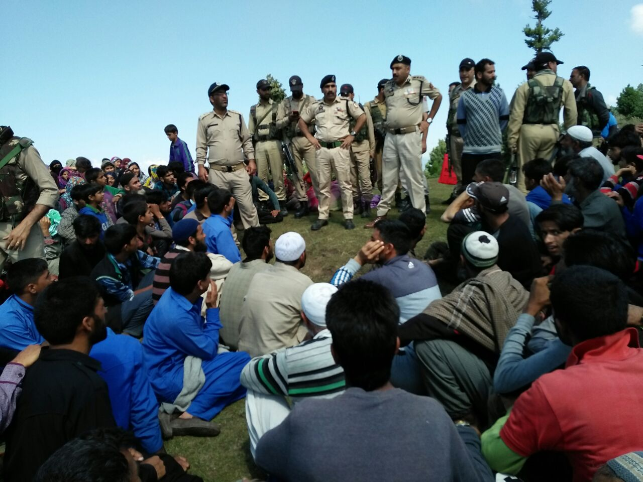 District police officials with villagers at Trehmokh Top.