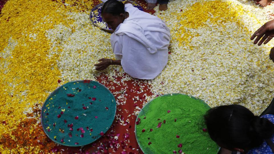 A widow arranges petals and 'gulaal' before Holi celebrations in Vrindavan. (Credit: Sanchit Khanna/HT Photo)