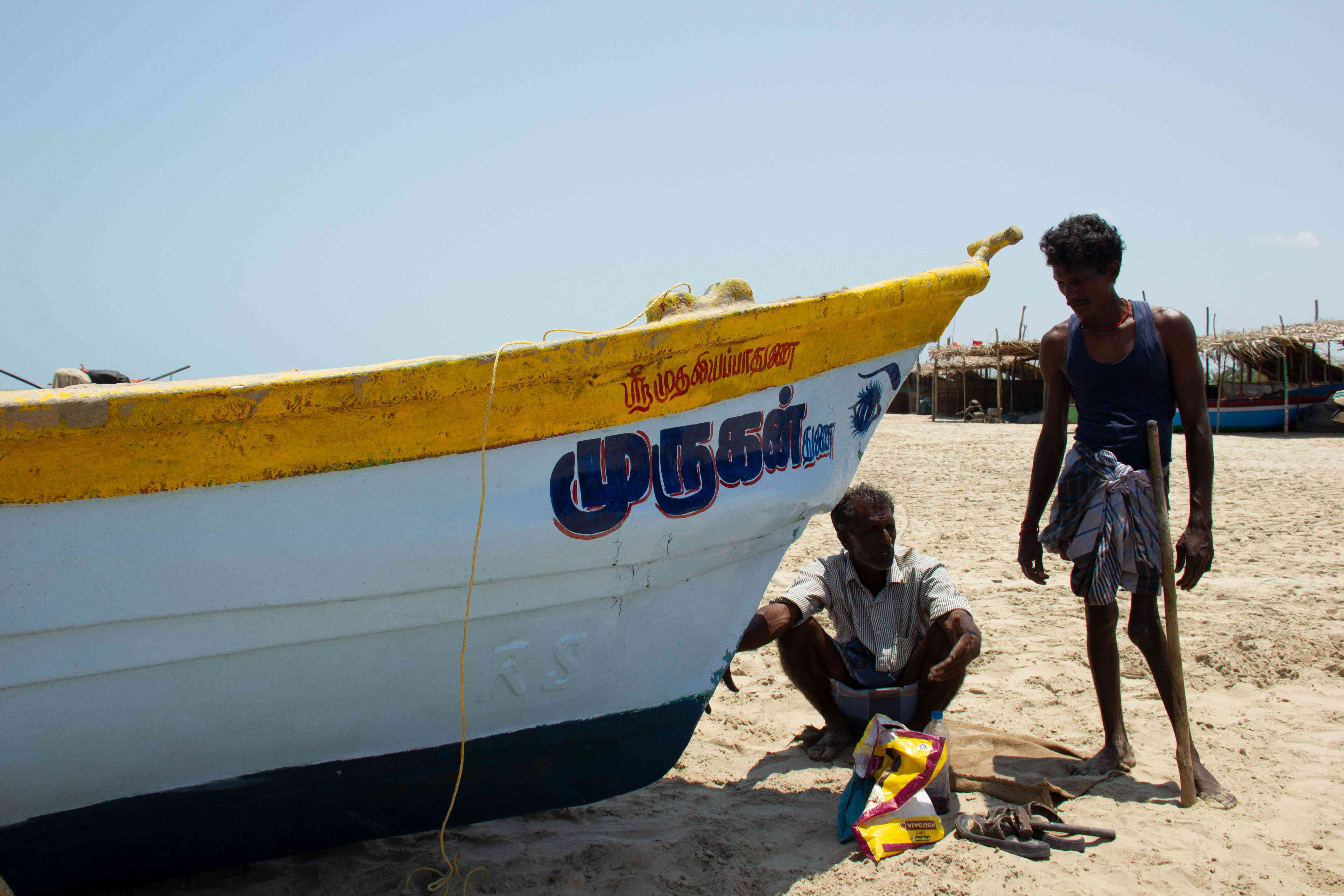 Sakthivelan K, who owns a fibre boat, inspects his damaged boat after finishing minor repair works at Arucottuthurai village in Nagapattinam in Tamil Nadu. Photo Credit: M Palanikumar|Pepcollective