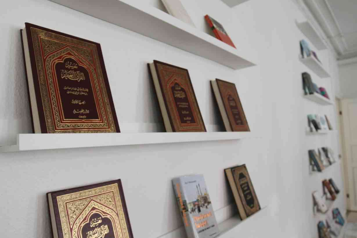 Islamic books line the walls of the main prayer room at Mariam Mosque in Copenhagen. (Photo credit: Lin Taylor/Thomson Reuters Foundation)