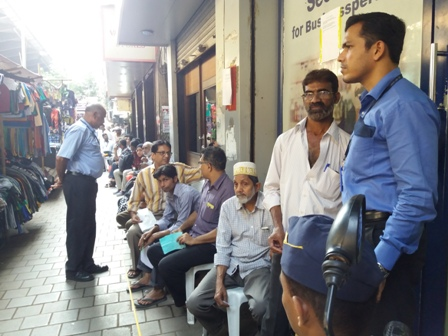 Citizens seated in line outside a bank at Crawford Market, Mumbai.