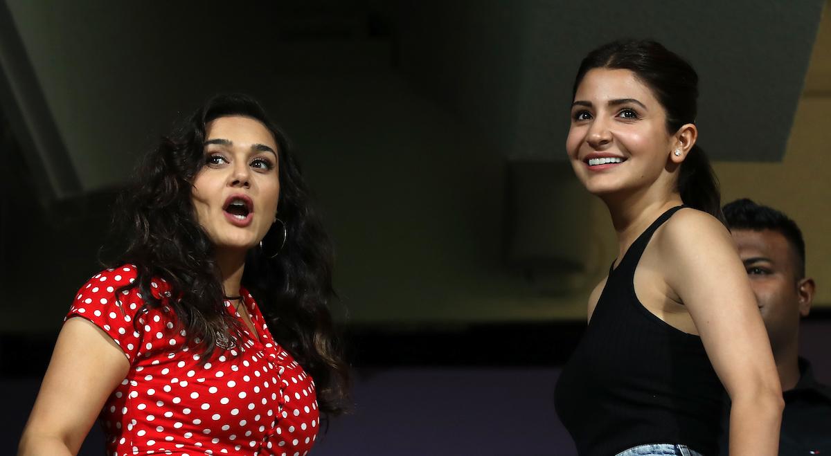 RCB skipper Virat Kohli's wife Anushka Sharma in conversation with KXIP co-owner Preity Zinta | Image courtesy: Sandeep Shetty/SPORTZPICS
