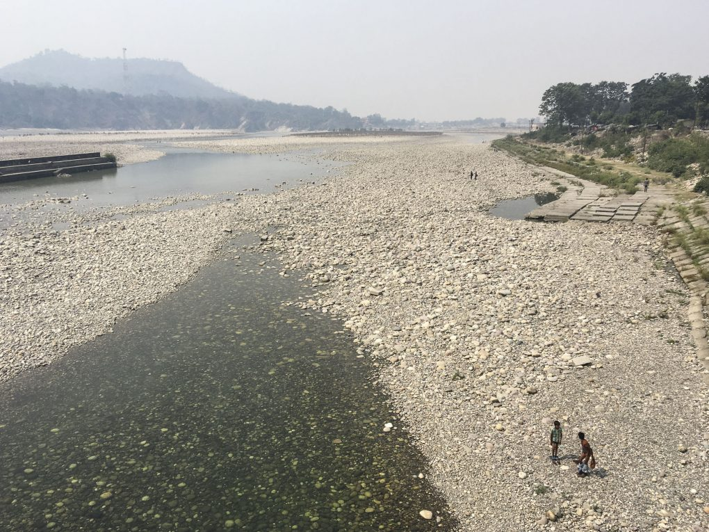 The largely dry river bed of the main channel of the Ganga at Haridwar on the day of the Ganga Dussehra.