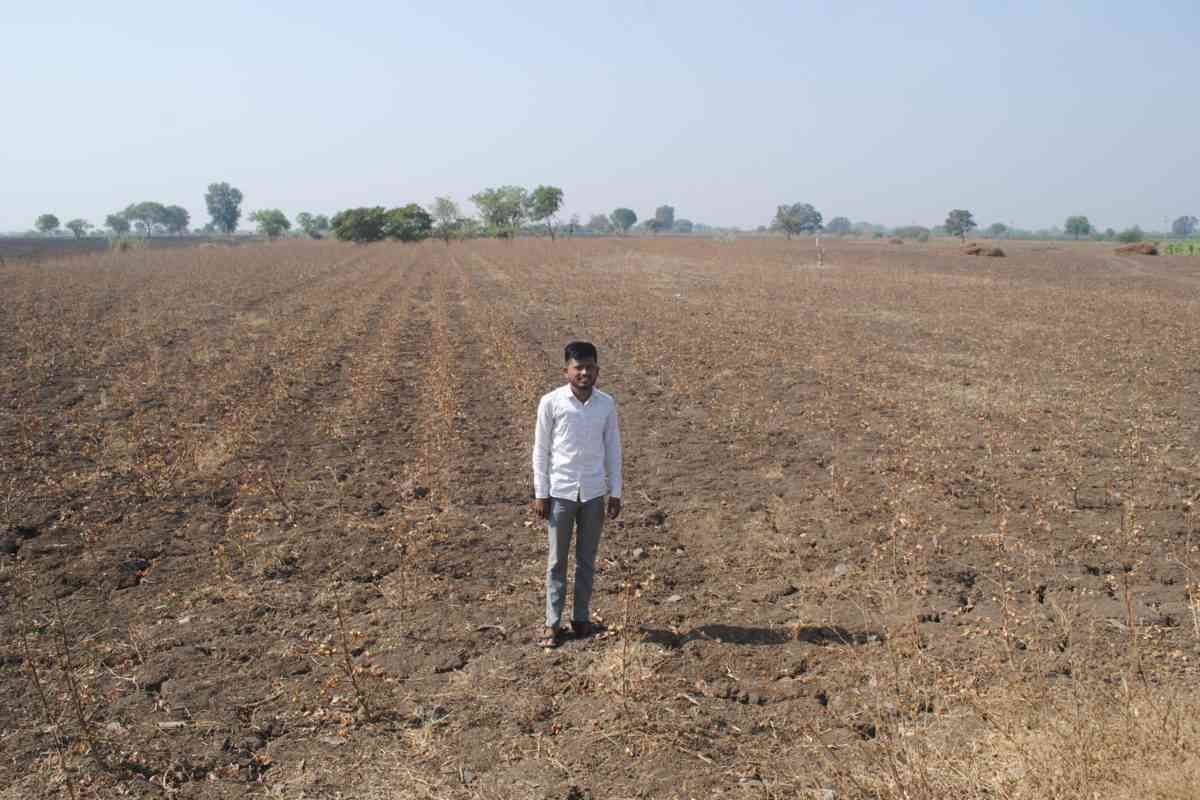 Balasaheb Dake whose father committed suicide in 2015, at his barren field in Kajala village near Jalna. (Photo credit: Meena Menon).