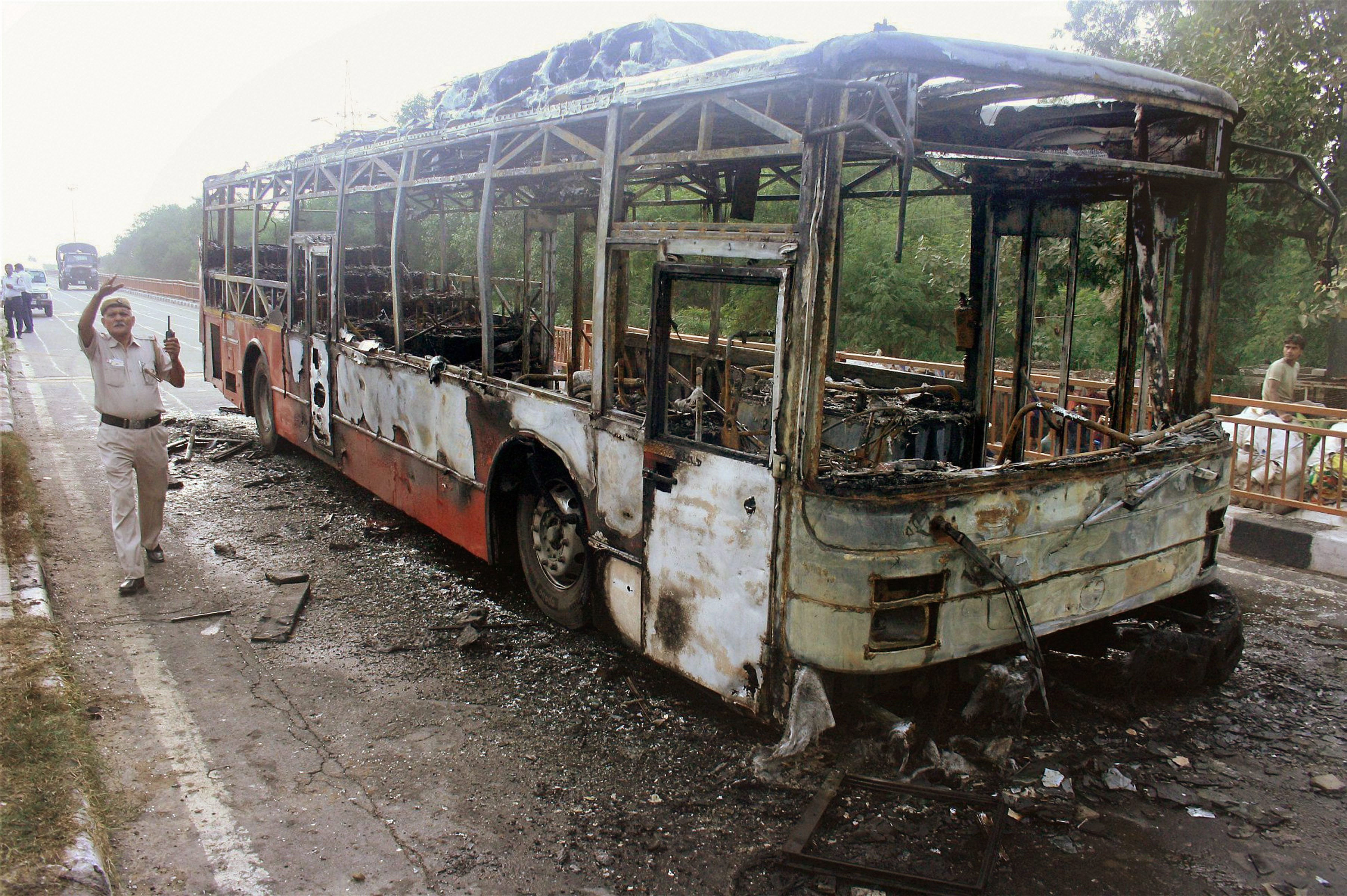 The skeleton of a Delhi Transport Corporation bus that was set on fire by Ram Rahim's followers (Credit: PTI)