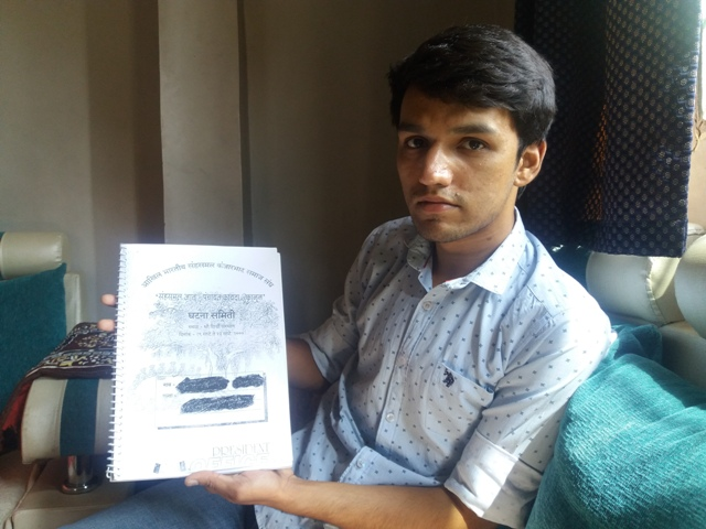 "Siddhant Indrekar with a copy of the ""Kanjarbhat constitution"". Photo: Aarefa Johari"