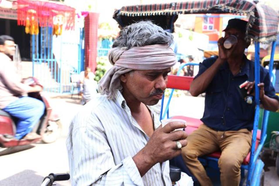 Customers drink sattu ka ghol at a roadside stall. Photo credit: HT Photo
