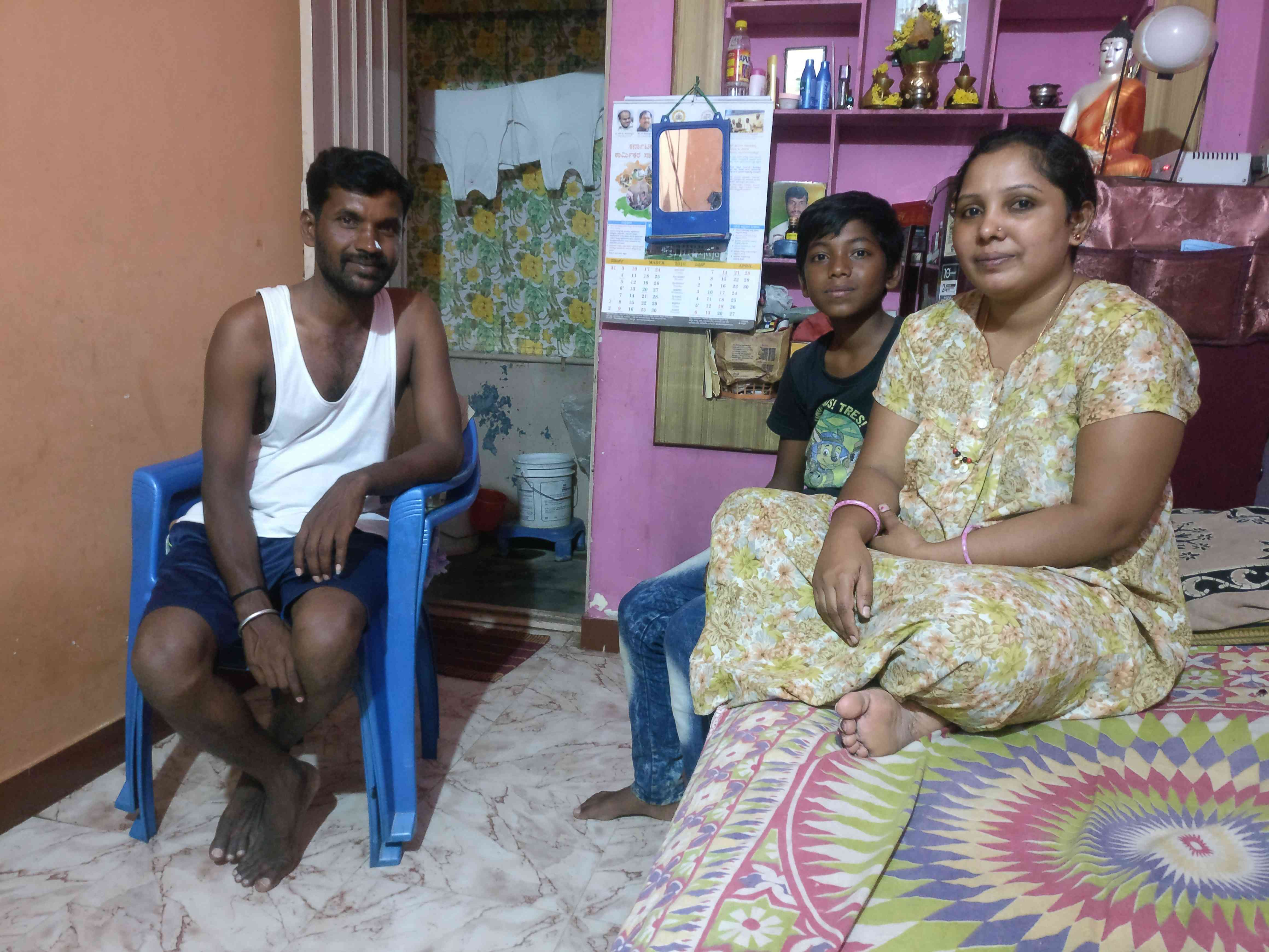 Saritha with her husband Chandru and older son Prithvi sit in the front room of their rented two-room house to watch an Indian Premier League match between Chennai Super Kings and Royal Challengers Bangalore. (Photo: Nayantara Narayanan)