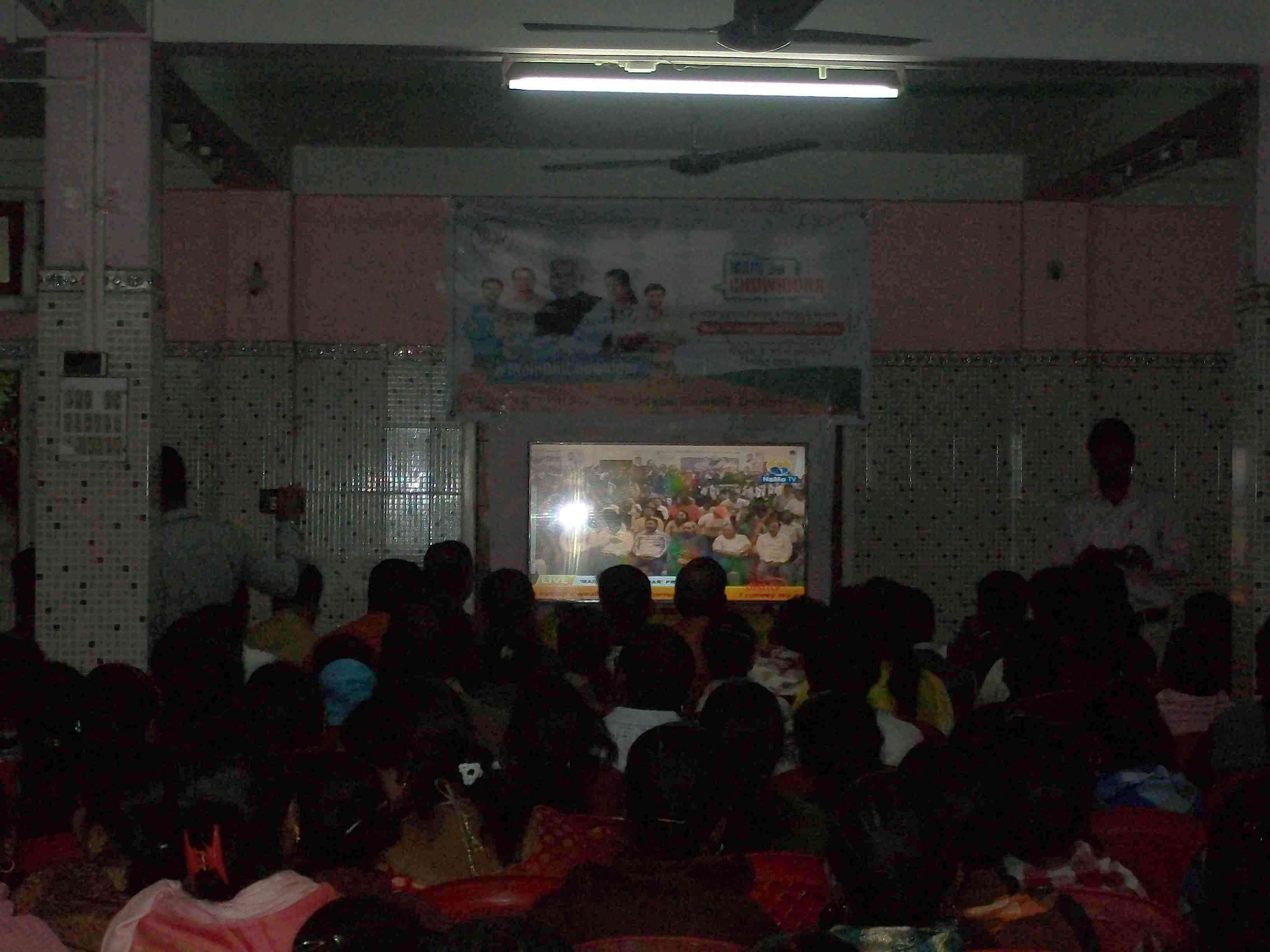 Bengali Hindus in Dhubri town gather for a screening of 'Main Bhi Chowkidaar' on NaMo TV. (Photo credit: Ipsita Chakravarty).