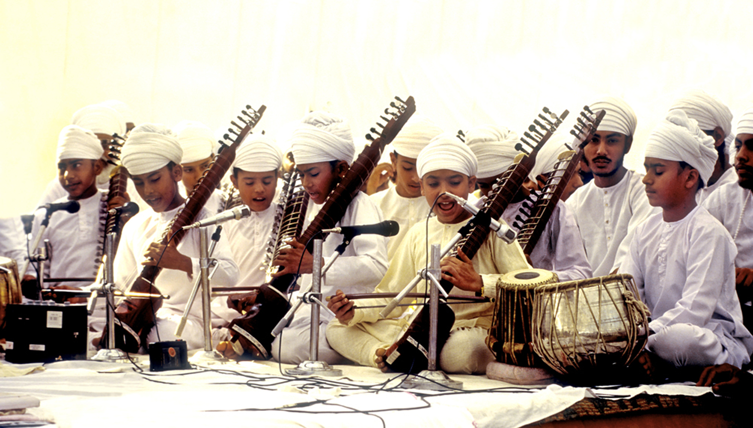 Children performing on stage, most of them play the dilruba. Image credit: V Dikshit