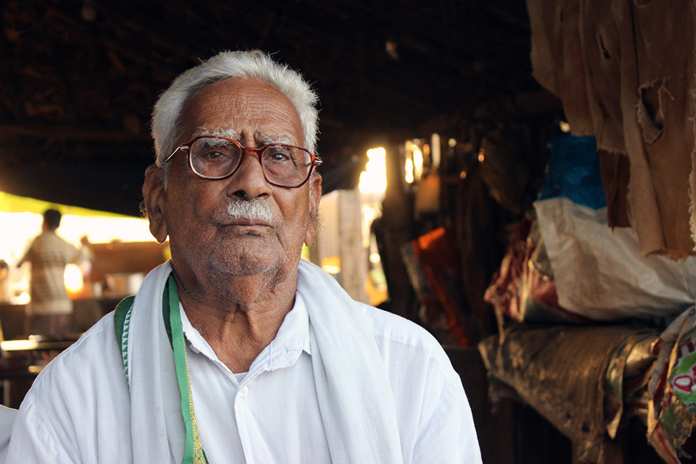 V Sreeselam is a farmer for 60 years. He cultivates five acres of his land and 17 acres of his family land in Lankapalli Village in Krishna, Andhra Pradesh. He needed about 80 bags of fertilisers for his crops this season but the machines do not read his fingerprints for biometric authentication. He has to request the fertiliser seller to adjust his sale on other farmers' Aadhaar cards everytime. Photo by Kumar Sambhav