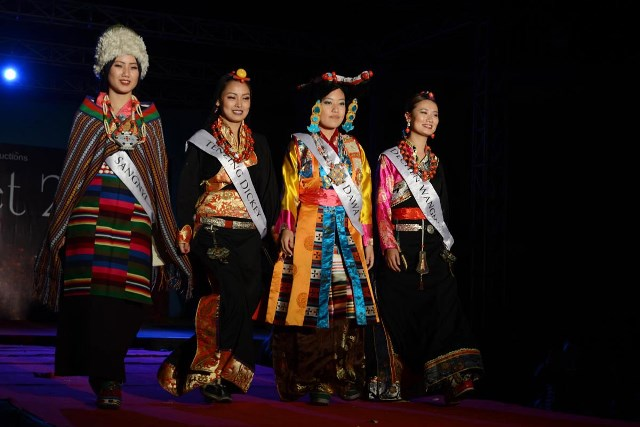 The four finalists in chuba, the traditional Tibetan attire.