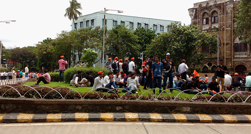 Protestors lounged in traffic islands and parks in south Mumbai while waiting for the main body of the rally to reach Azad Maidan. Photo: Mridula Chari